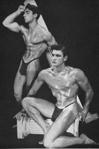 two vintage bodybuilders posing together