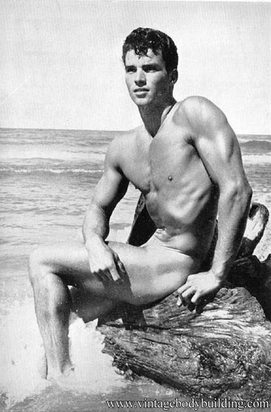 muscle man on the shore
