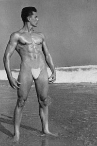 vintage muscle man posing outdoors