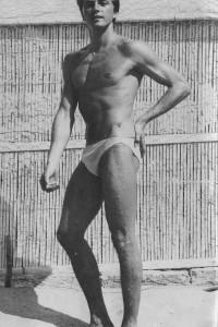 vintage muscle model posing outside