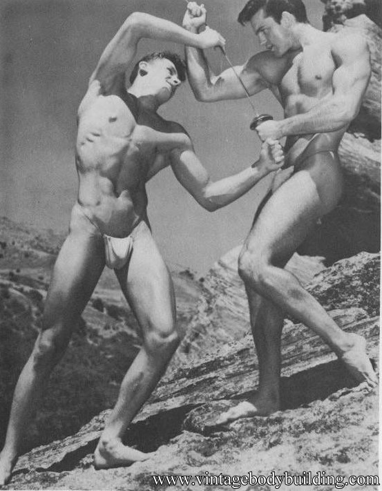 two bodybuilders fighting outdoors