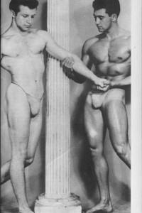 two muscle men posing together