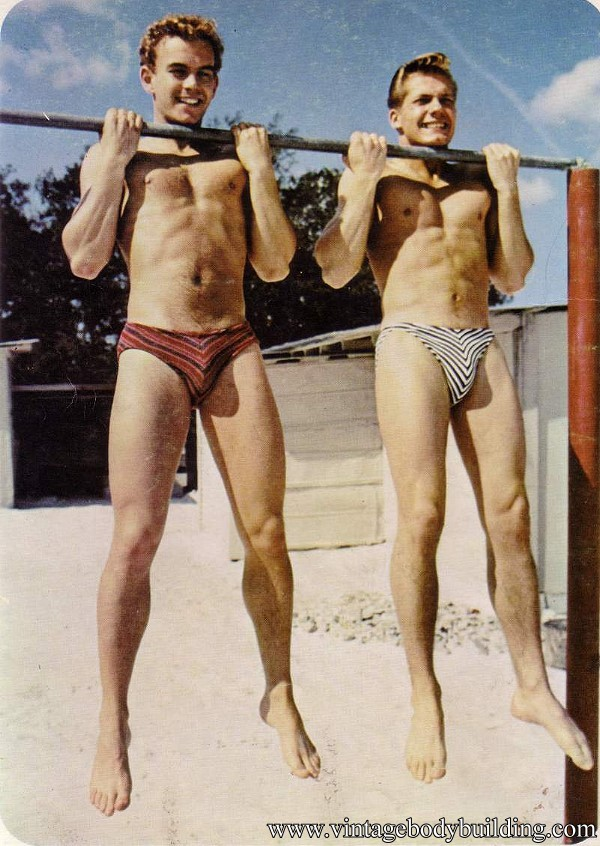 two young muscle guys outdoors