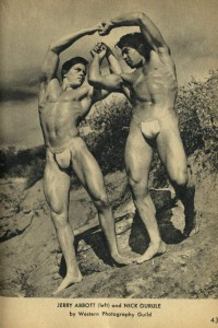 two bodybuuilders posing outdoors