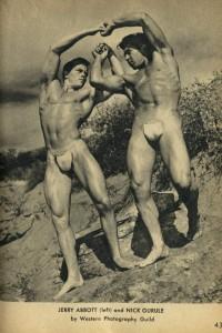 two bodybuuilders posing outdoors