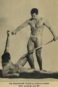 two vintage muscle men posing